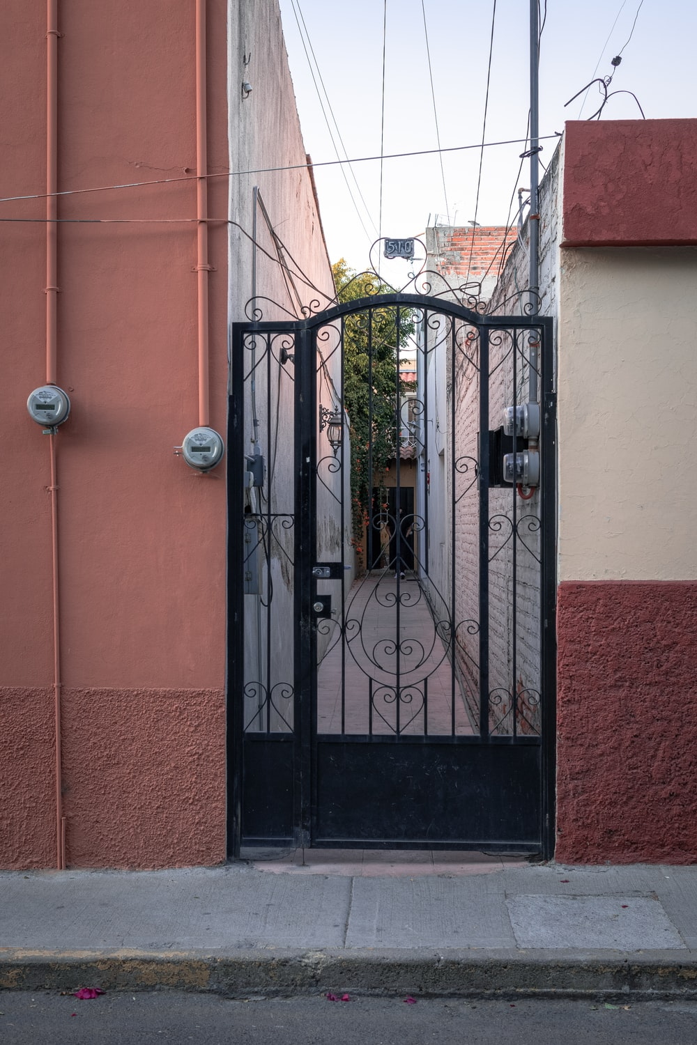 black metal gate on red concrete building