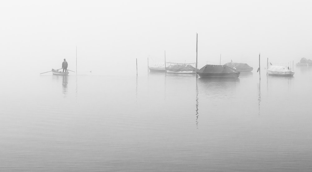 grayscale photo of boat on body of water