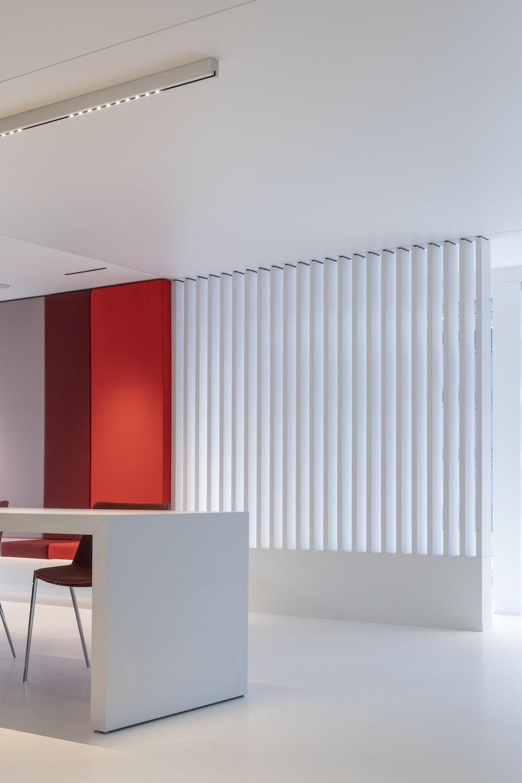 white wooden table near white window blinds