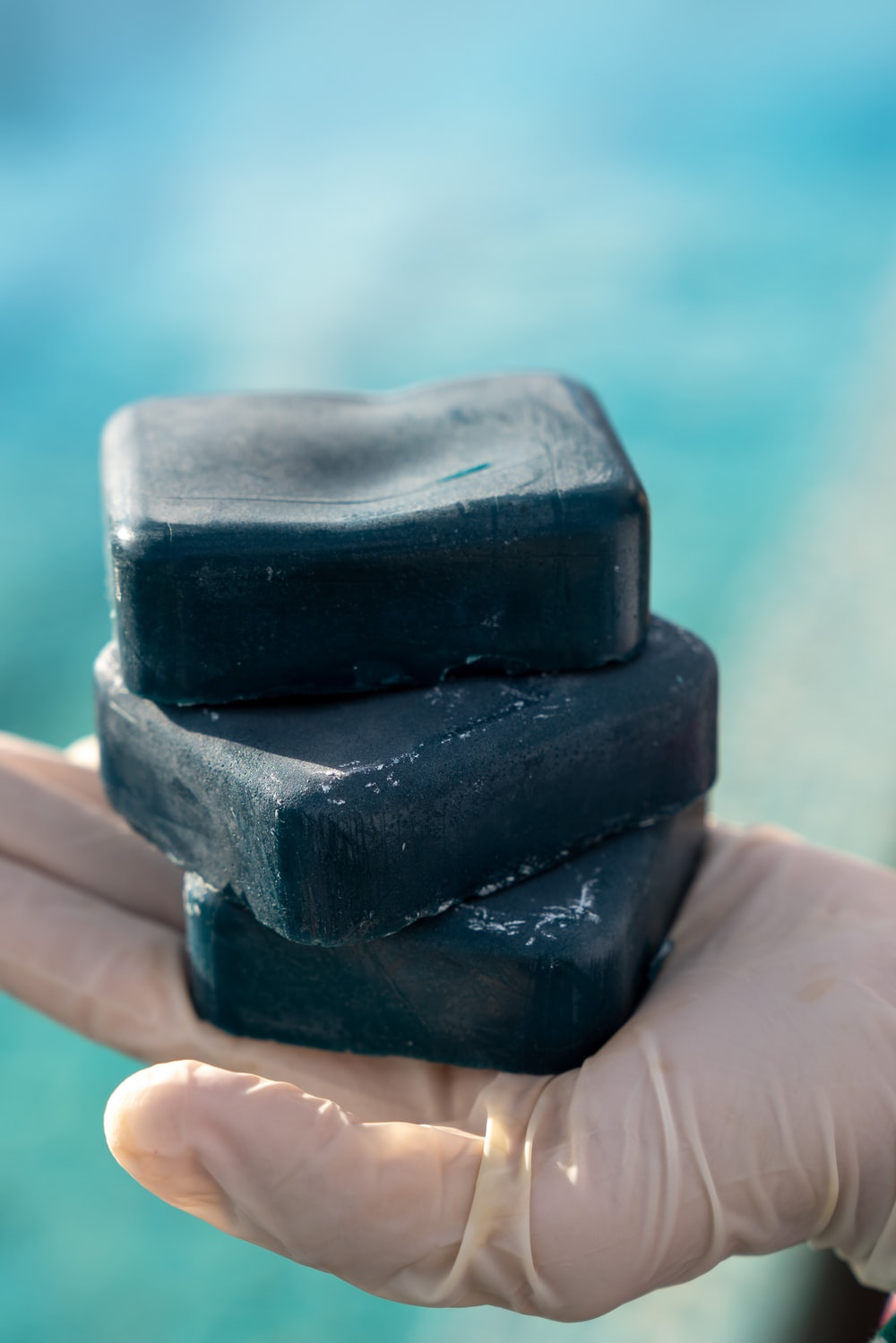 person holding black stone fragment