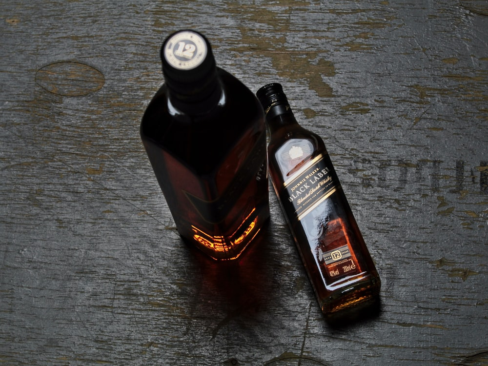 black and red labeled bottle