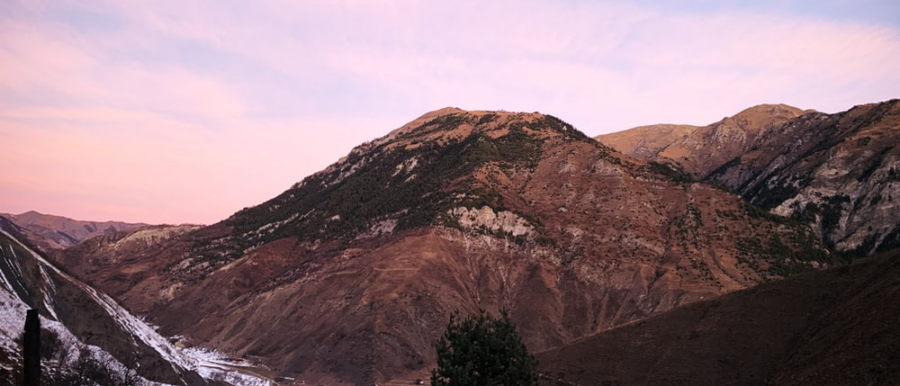 brown mountain under white sky during daytime