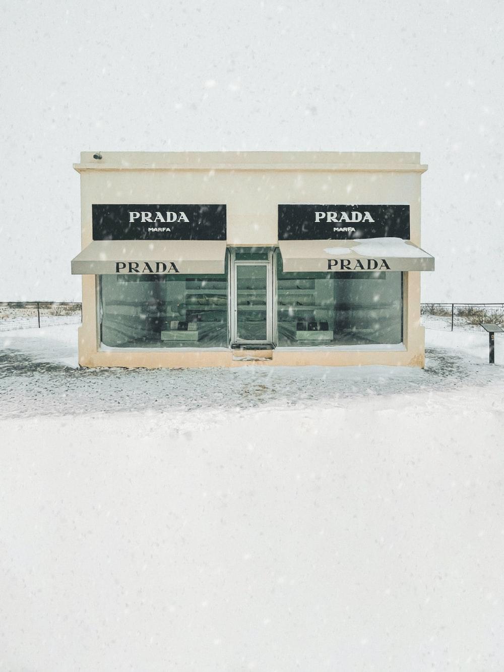 white wooden signage on white snow