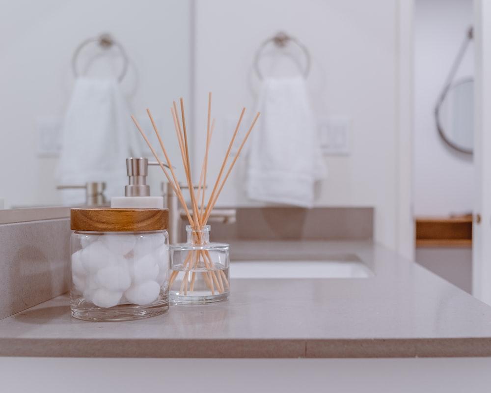clear glass jar with brown sticks