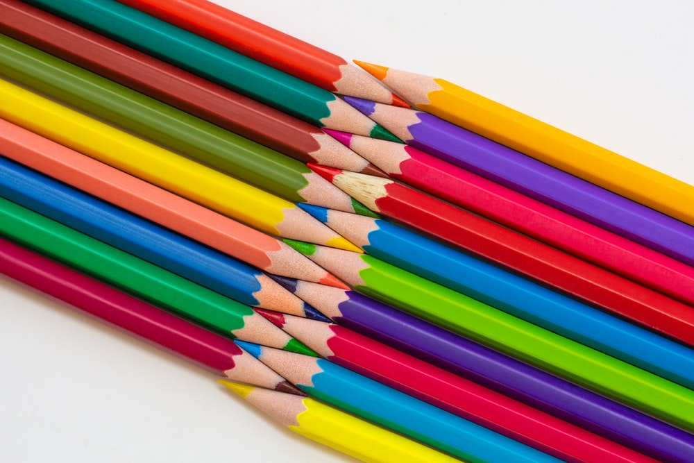 multi colored coloring pencils on white surface