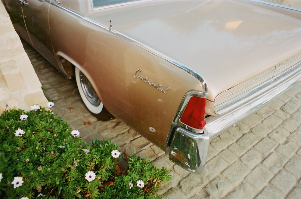 brown classic car on brown brick floor