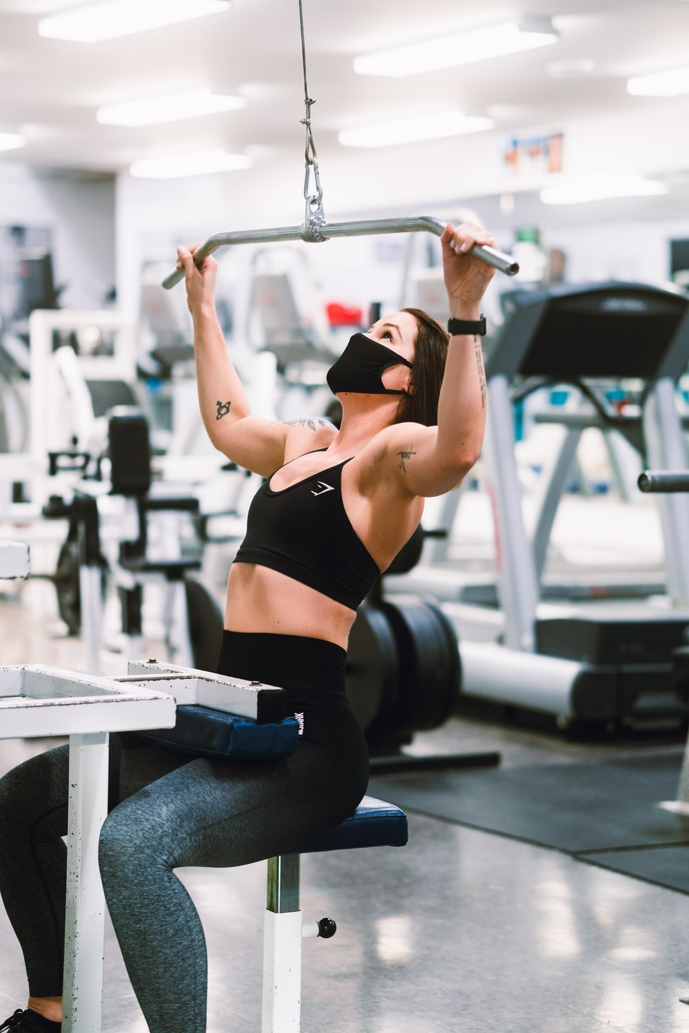 woman in black sports bra and blue denim jeans doing exercise