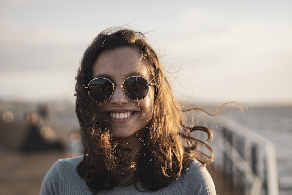 woman in blue sweater wearing black sunglasses