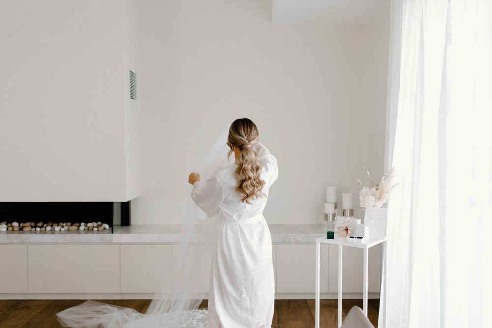 girl in white dress standing on white table