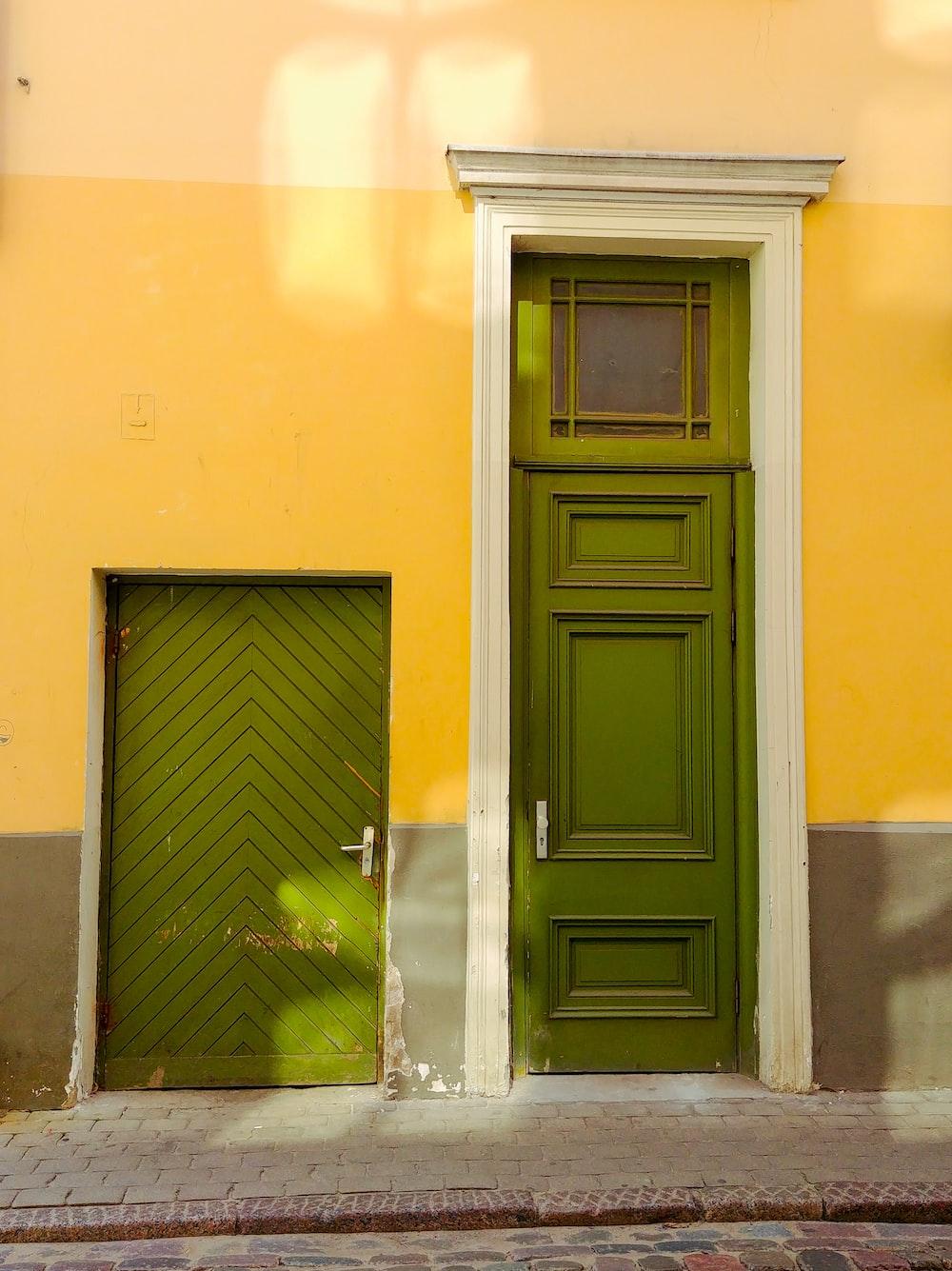 black wooden door on yellow painted wall