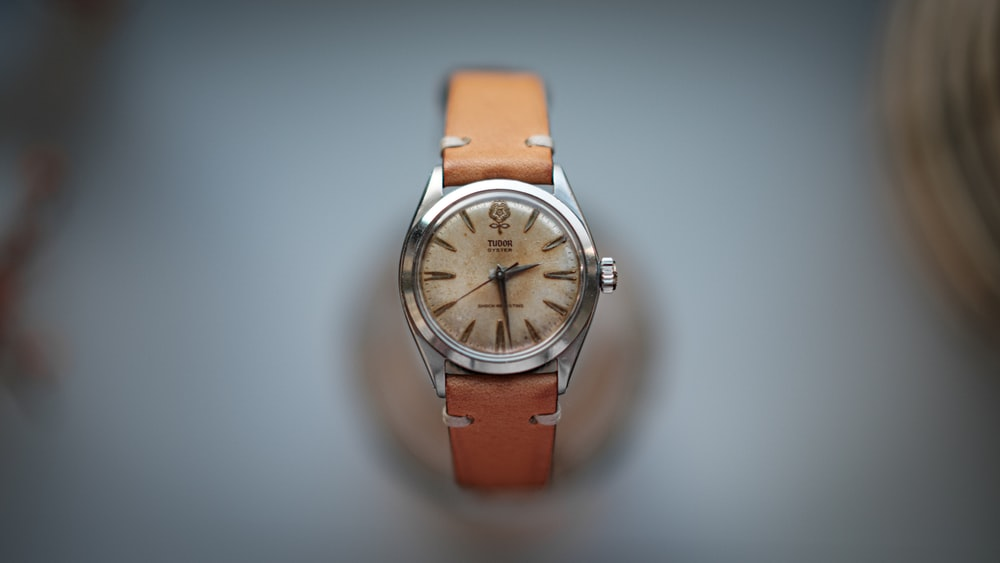 silver and white analog watch