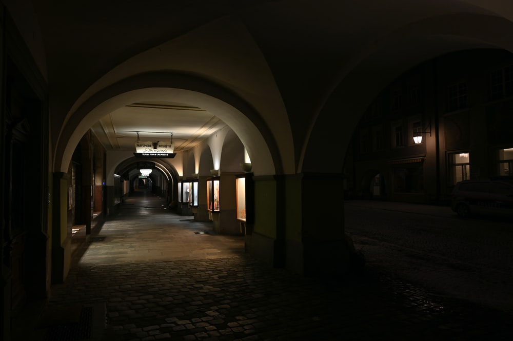 hallway with lights turned on during night time