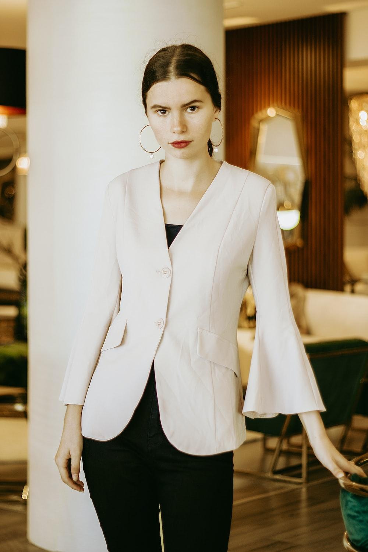woman in white blazer and black dress