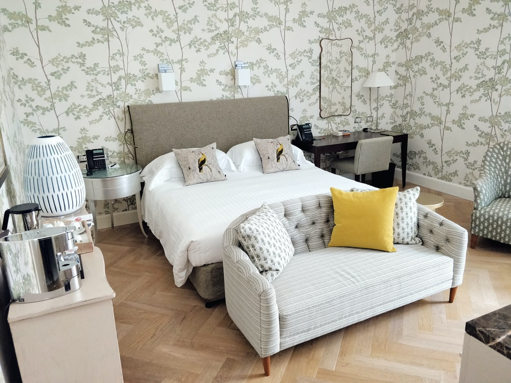 white and brown floral sofa