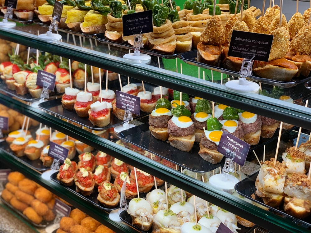 assorted pastries on white steel rack