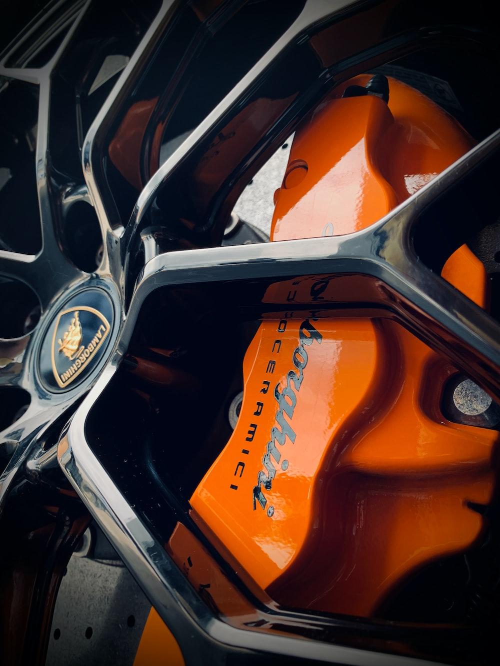 orange and black car steering wheel