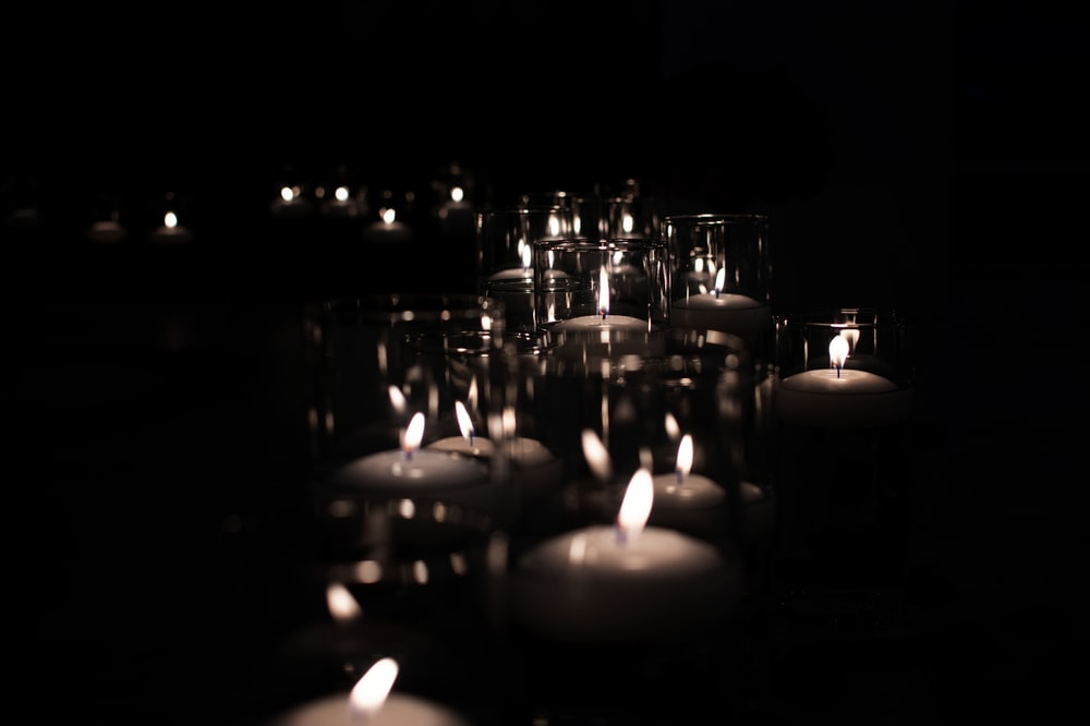 lighted candles on black surface