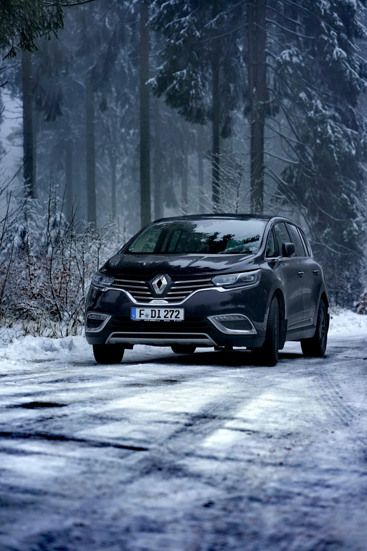 black volkswagen sedan on snow covered road