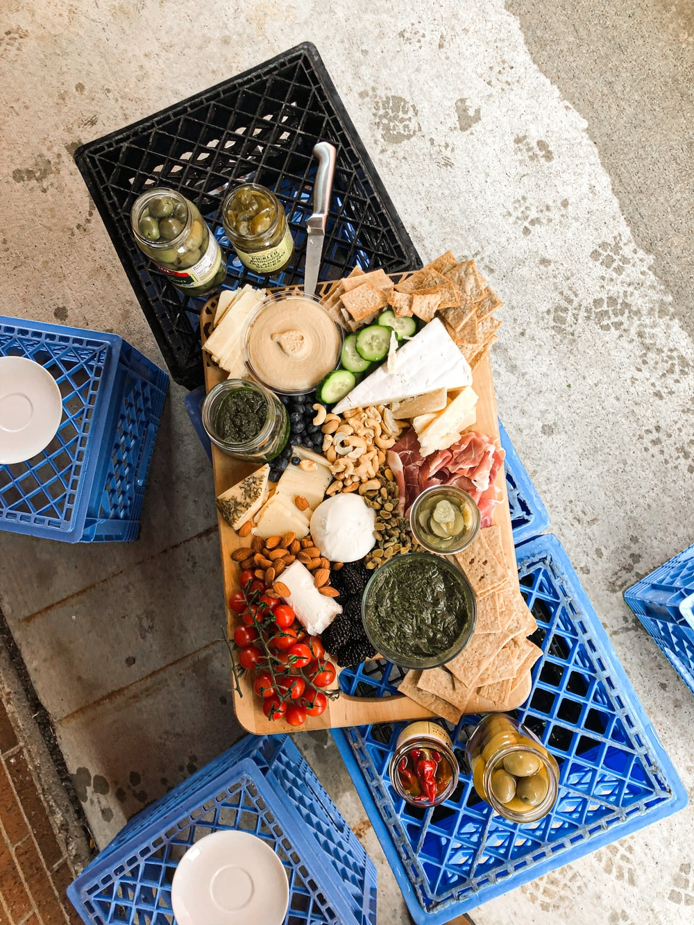 assorted food on blue plastic crate