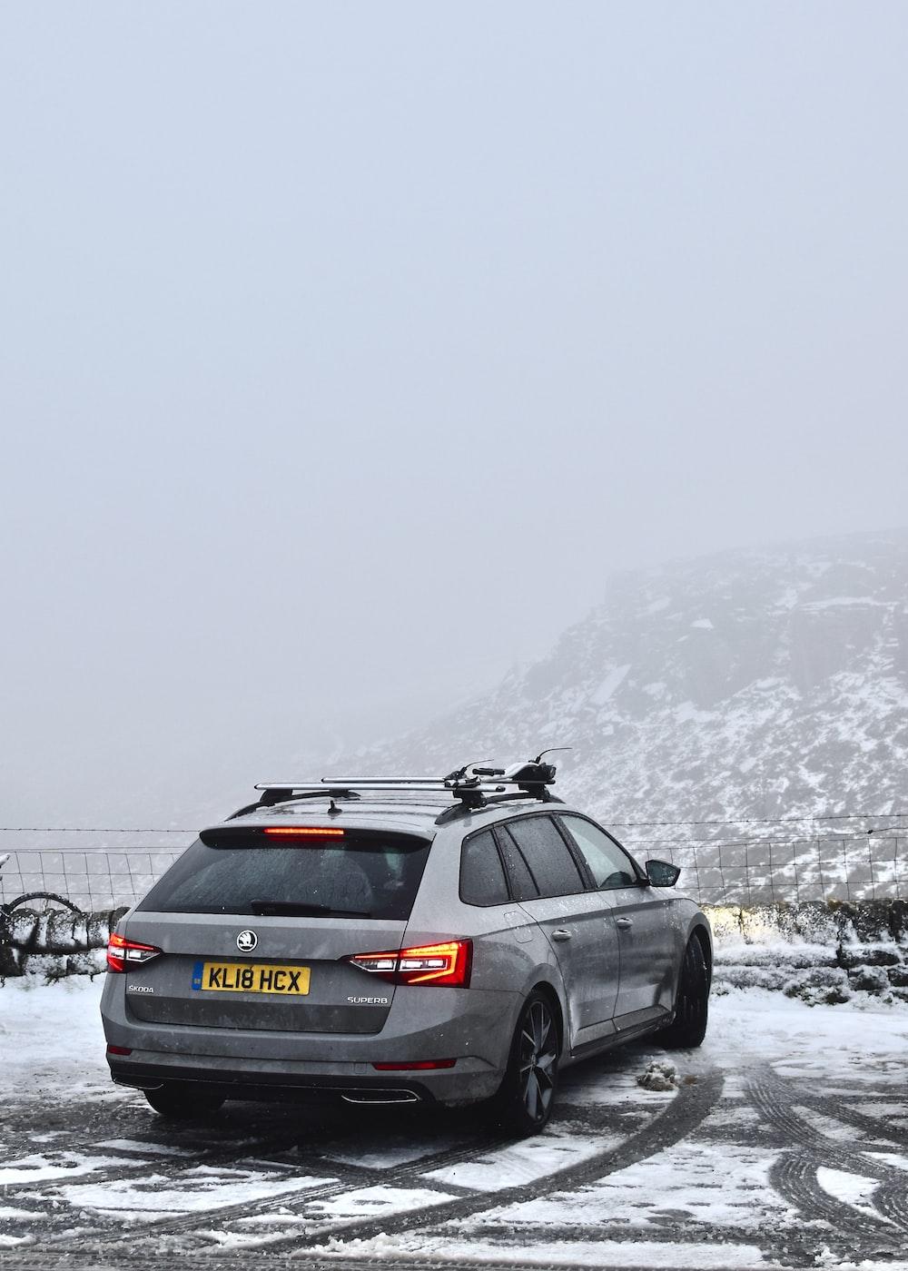 black honda car on snow covered ground during daytime