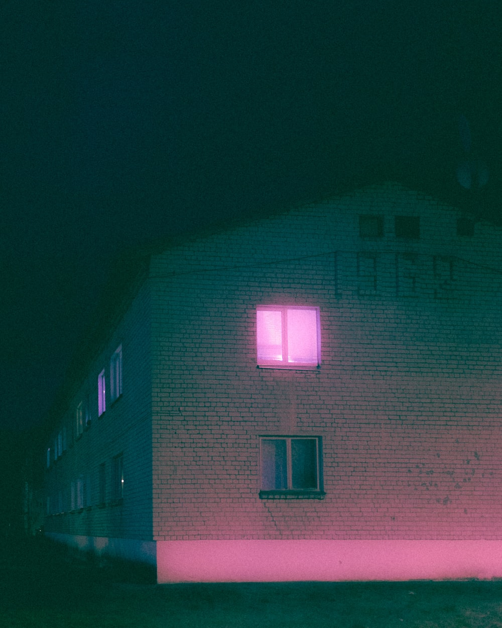 pink and white concrete building during nighttime