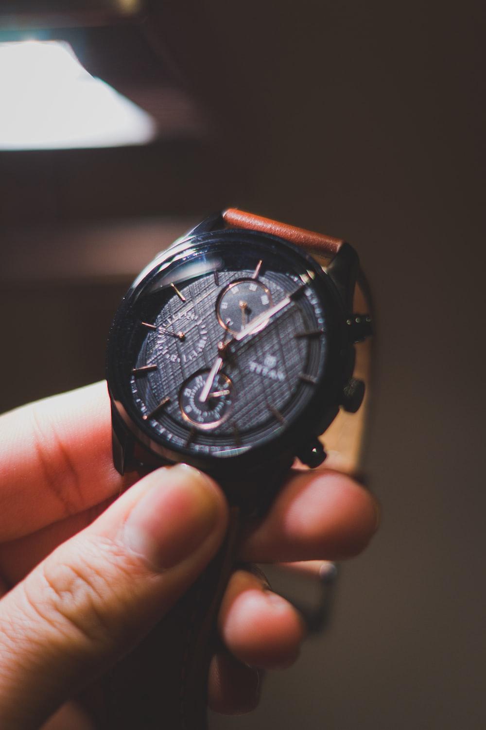 black and orange chronograph watch