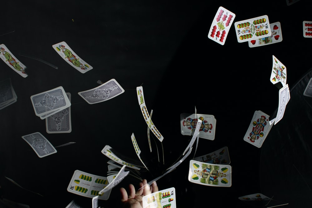 playing cards on black textile