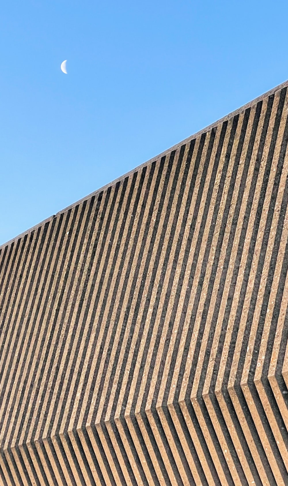 brown and black concrete building under blue sky during daytime