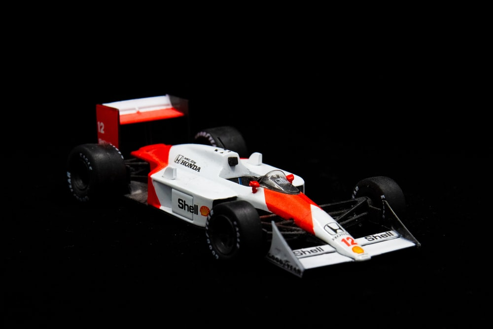 white and orange f 1 car toy