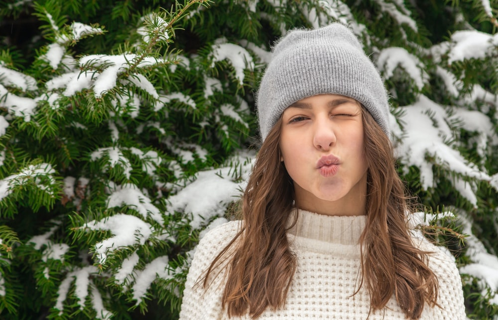 girl in white knit cap and white knit sweater