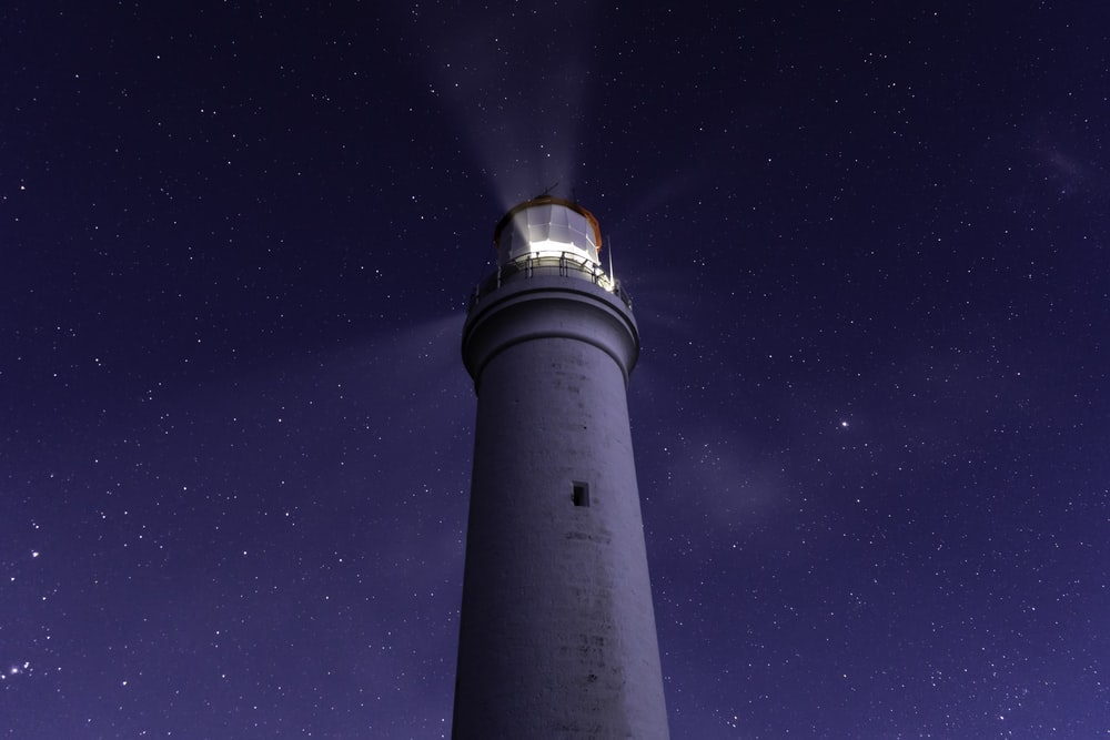 white light tower under blue sky during night time