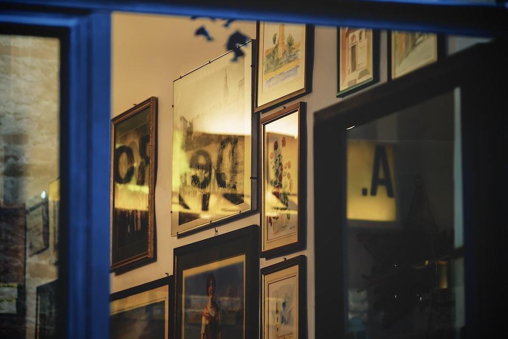 black wooden framed photos on blue wall