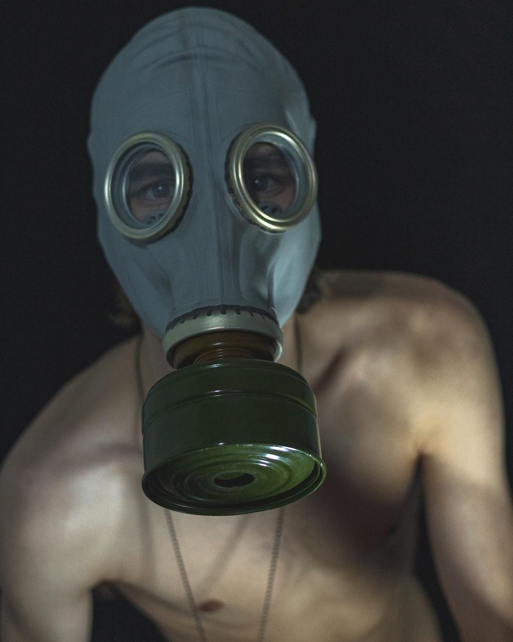 topless man wearing black gas mask