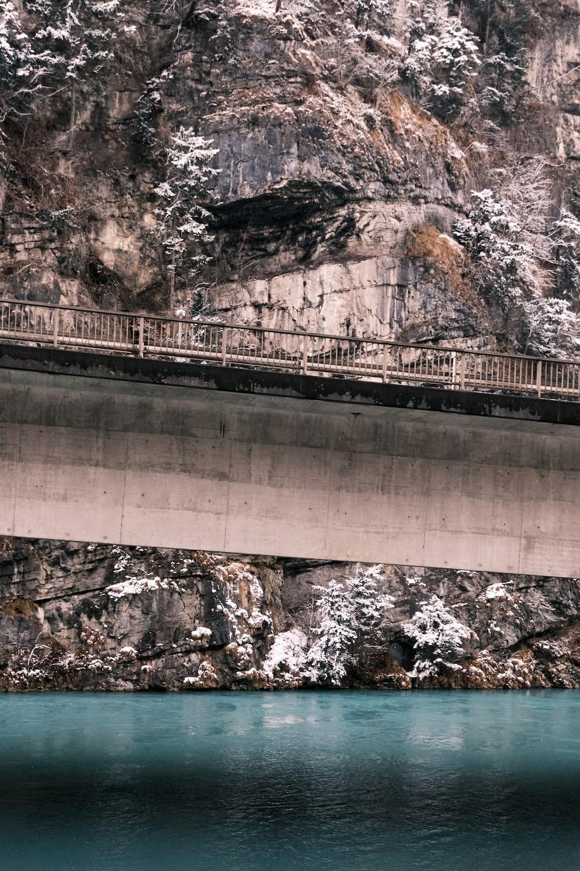 gray concrete bridge over river