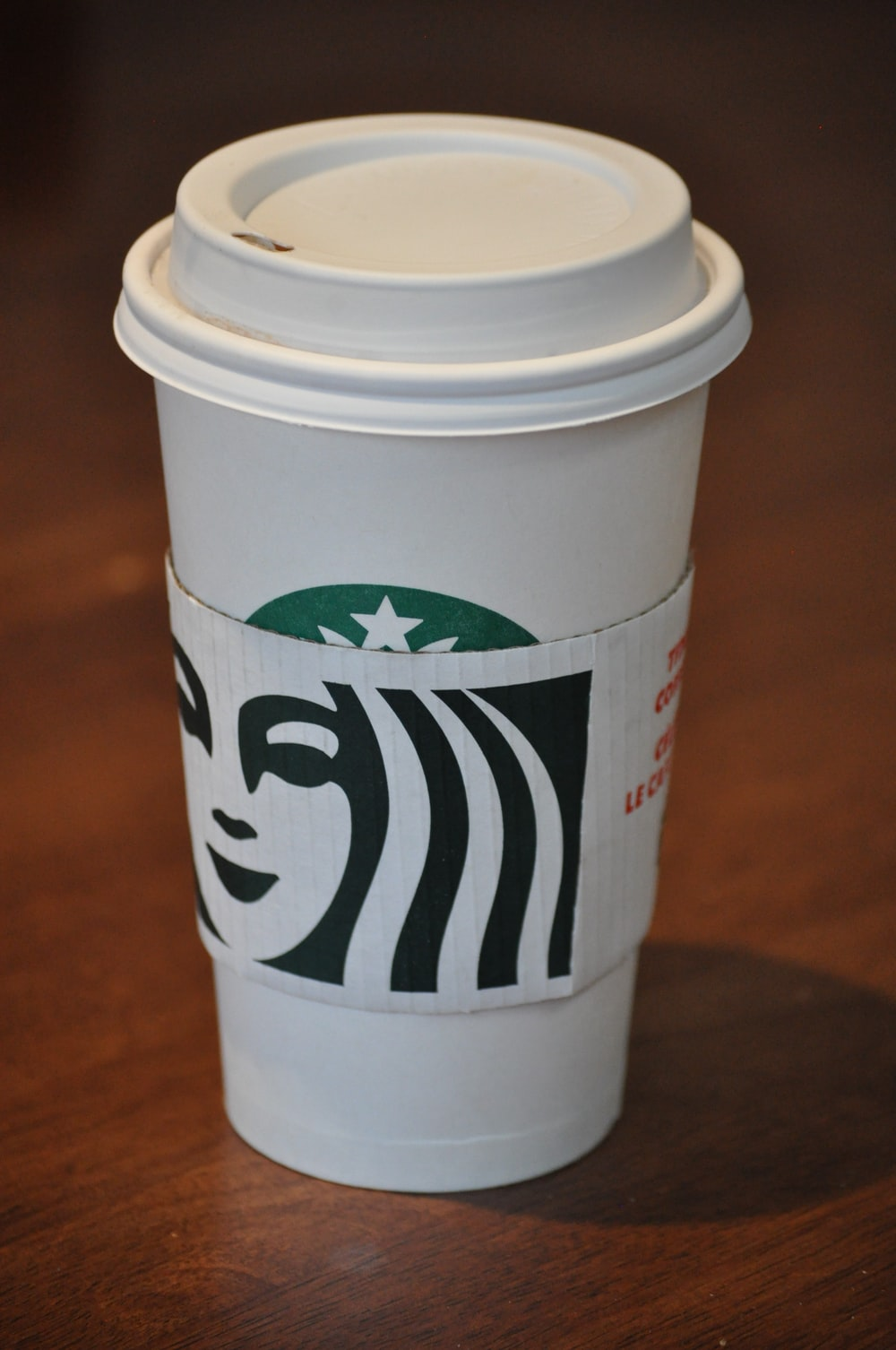 white and green starbucks disposable cup