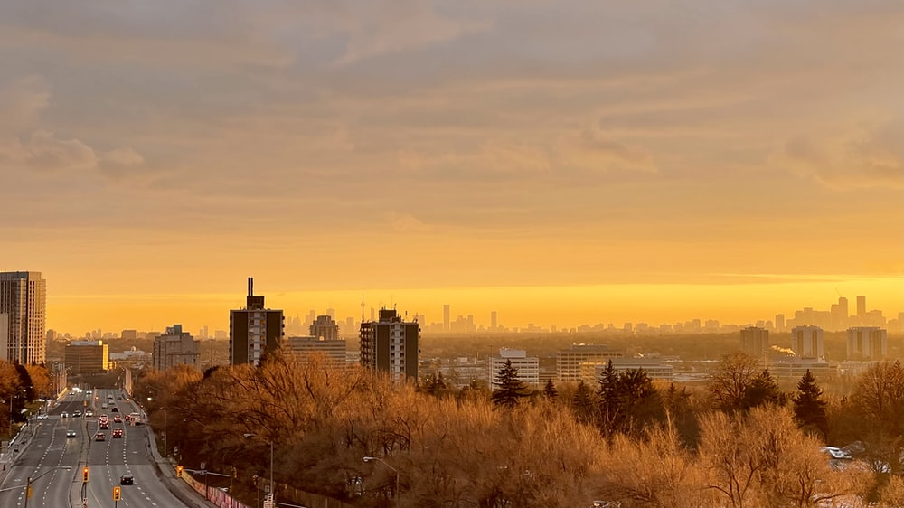 city skyline during sunset with yellow sky