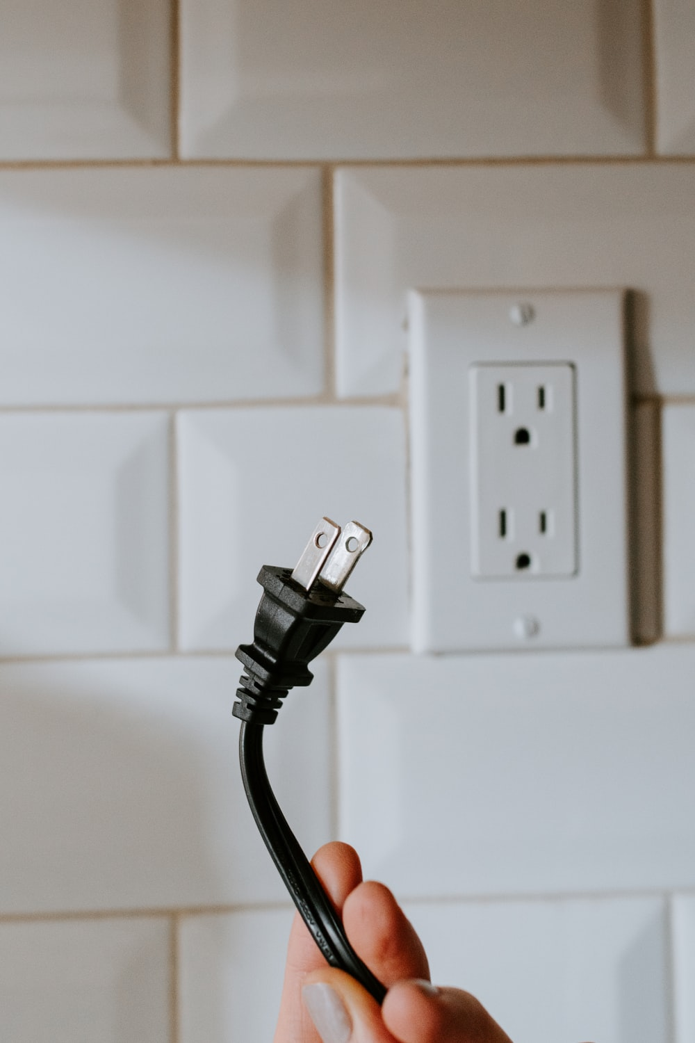 black usb cable plugged in white electric socket