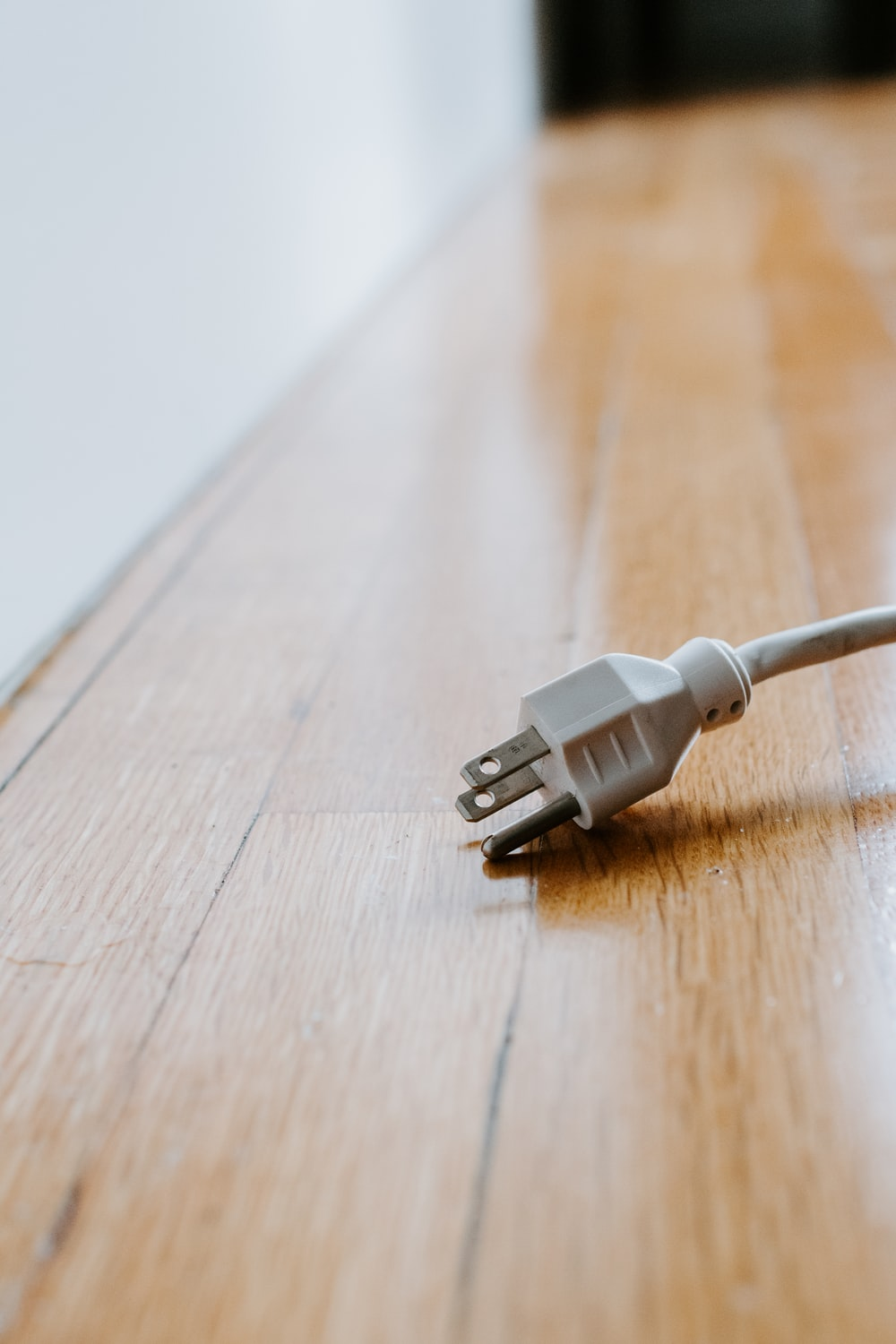 white usb cable on brown wooden table