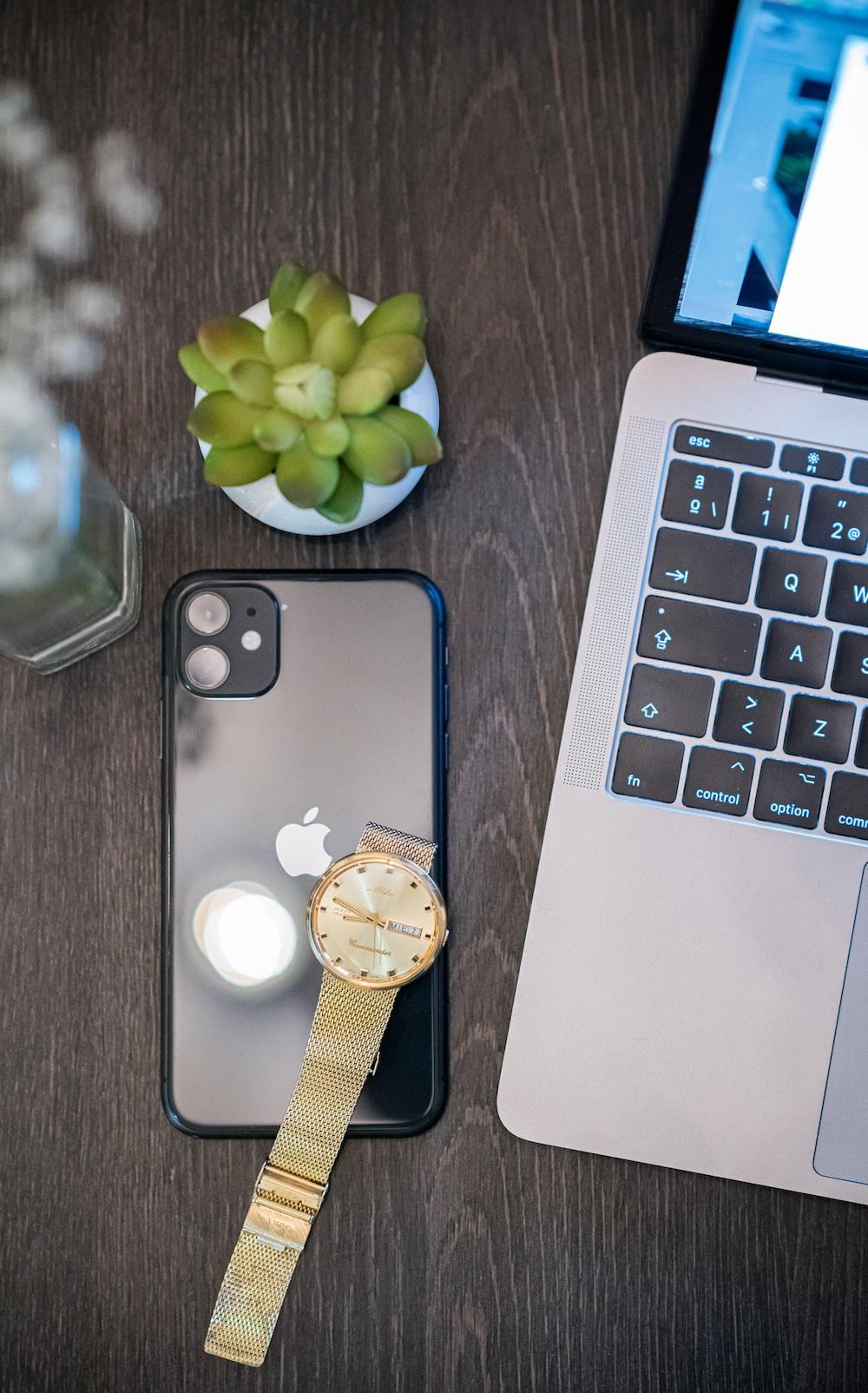 silver iphone 6 beside macbook pro
