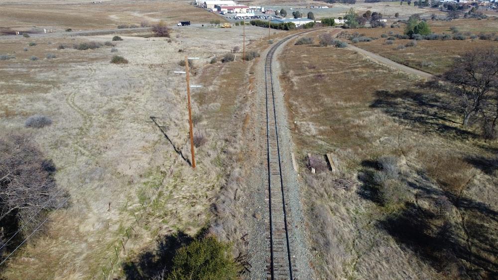 white and brown train on rail tracks