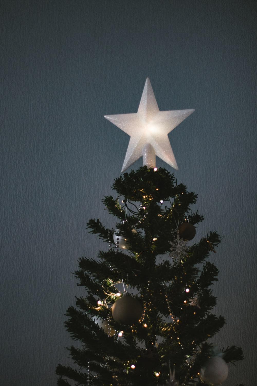 white star ornament on christmas tree