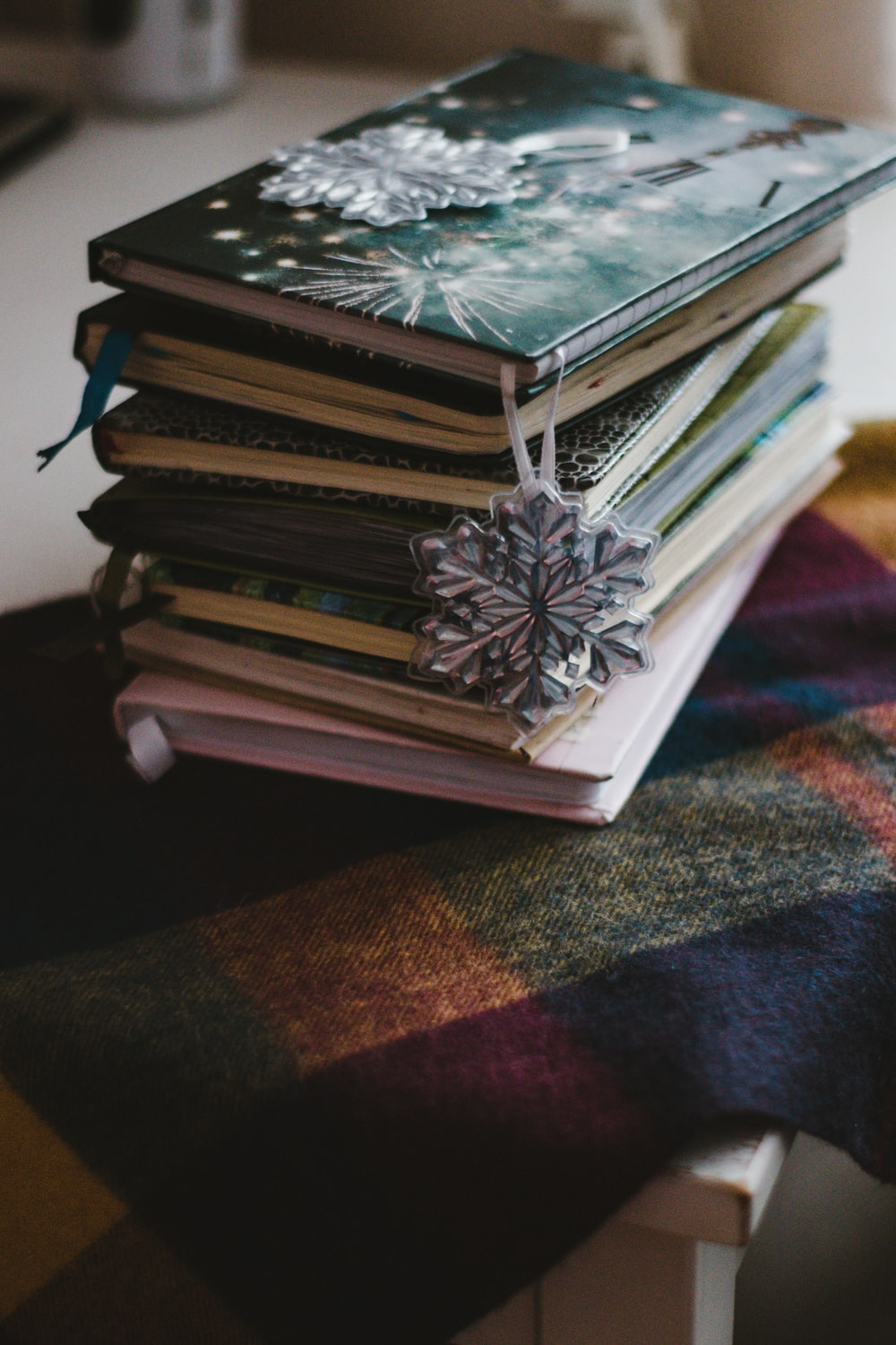 stack of books on brown and black textile