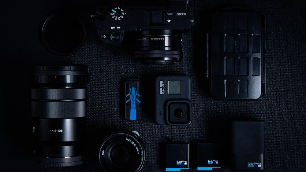 black dslr camera on black computer keyboard