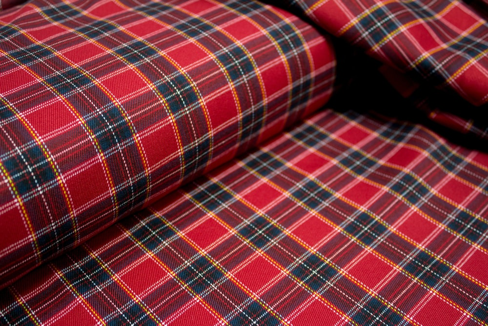 red white and black plaid textile