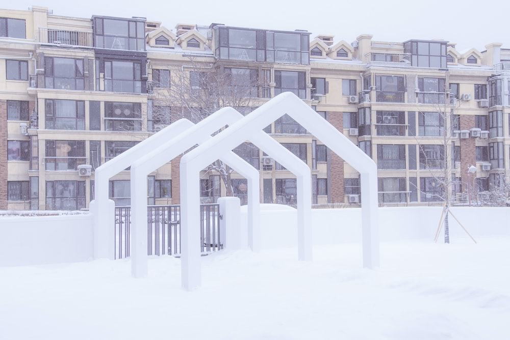 white and brown concrete building covered with snow during daytime