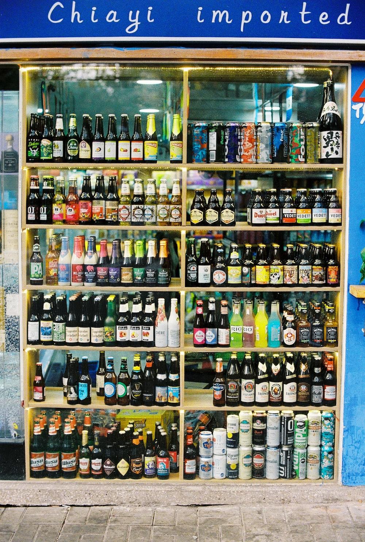 assorted glass bottles on shelf