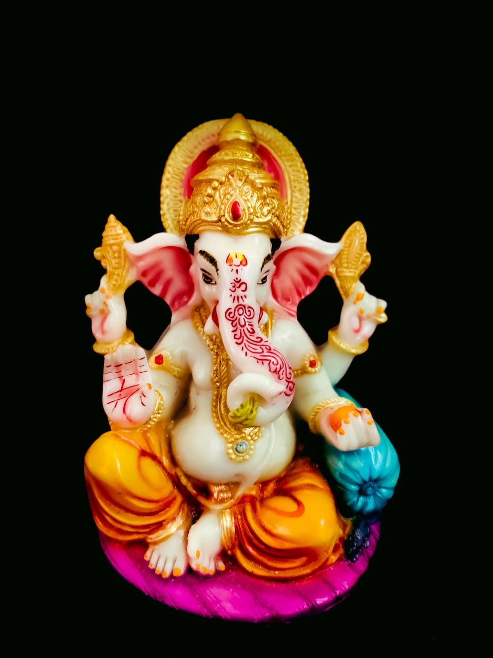 gold and red hindu deity figurine