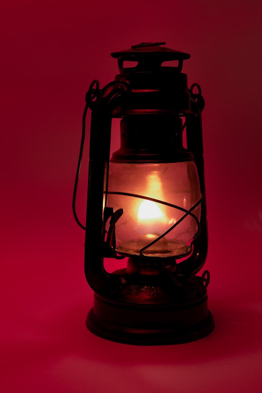 black lantern lamp turned on in red room