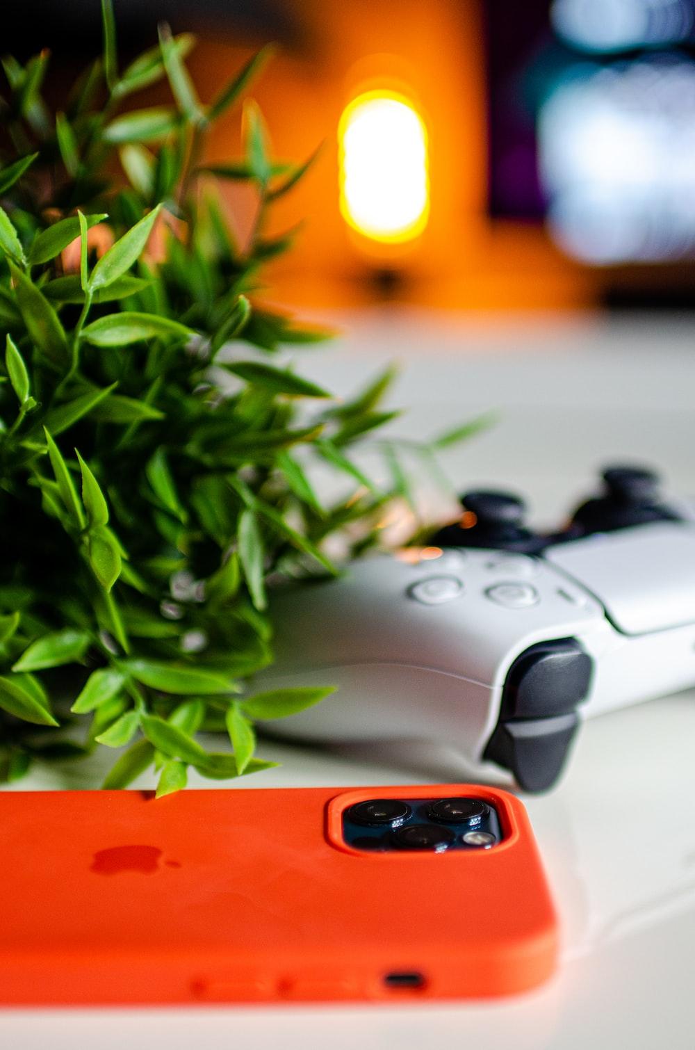 black and orange game controller