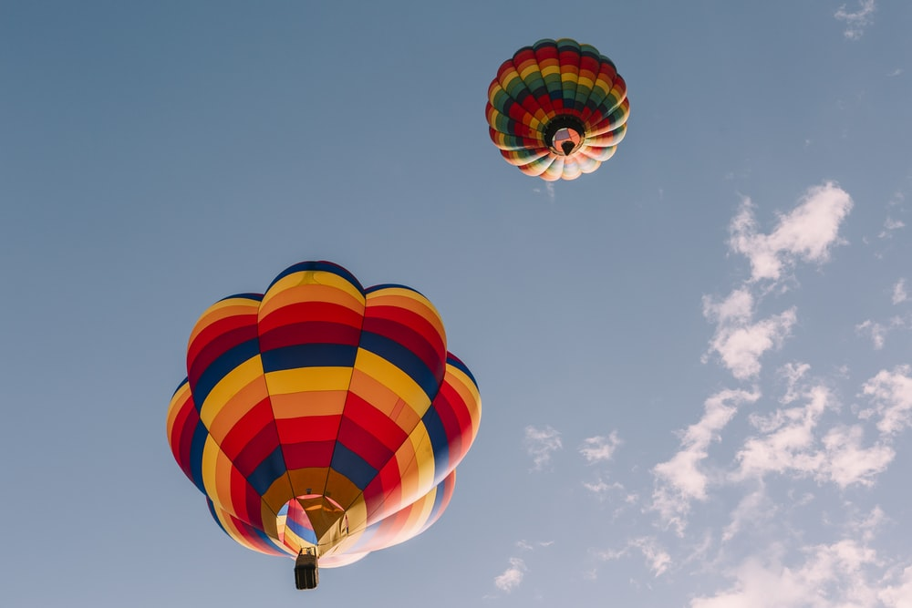 blue yellow and red hot air balloon in mid air